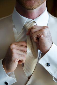 Cool detail shot of a groom tying his tie.  Tampa Wedding Photographer, Brian C Idocks Photographics LLC