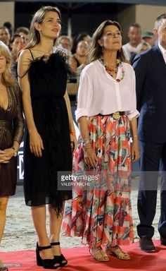 Charlotte Casiraghi (L) and Princess Caroline of Hanover (c) attend a ceremony during the 2017 edition of the Jumping International of Monaco horse jumping competition as part of the Global Champions Tour on June 24, 2017 in Monaco.  / AFP PHOTO / VALERY HACHE        (Photo credit should read VALERY HACHE/AFP/Getty Images)