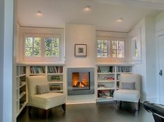 Interior Wall Room Divider Ideas Fireplace: Stunning Fake Fireplace Ideas For Family Space Contemporary Decor Ideas Also Stunning Baseboards Bookcase Bookshelves Fireplace Between Windows, Small Gas Fireplace, Bookshelves Around Fireplace, Wall Bookshelves, Fireplace Design, Fireplace Ideas, Bookcases, Book Shelves, Electric Fireplace