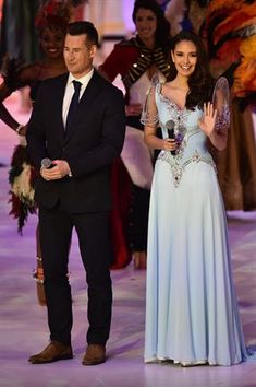 Tim Vincent (L) and Miss World 2013 Megan Young (R) present the grand final of the Miss World 2014 pageant. (Photo by AFP/Leon Neal) Grad Dresses, Event Dresses, Fall Dresses, Nice Dresses, Modern Filipiniana Gown, Filipiniana Wedding, Wedding Entourage Gowns, Wedding Dresses, Filipino Fashion