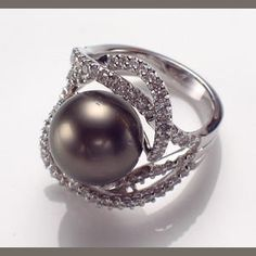 A Tahitian cultured pearl, diamond and eighteen karat white gold ring