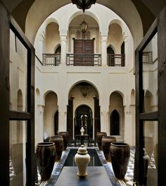 Moroccan architecture excellence at Riad Dar Darma. Lovely antique garden pots. #Moroccan #Luxury #Decor.