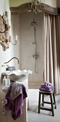 like the accent over the shower French Flair Bathroom - purple immediately gives a room a regal feel. Just the right amount