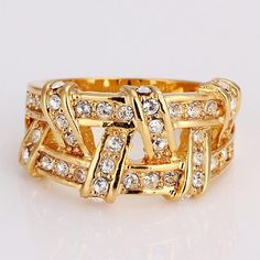 INALIS 18K Gold Simple Fashion Twisted CZ Diamond Ring - Size 7 http://www.madeinchina.com/pd/inalis-18k-gold-simple-fashion-twisted-cz-diamond-ring-size-7-113643#.VajHDUZAdZY