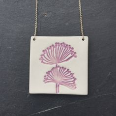 A personal favourite from my Etsy shop https://www.etsy.com/uk/listing/502379736/purple-glazed-flower-imprinted-large