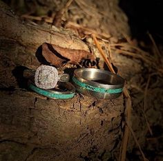 Detail wedding ring shot, containing custom handmade wedding bands. His and hers matching wedding bands featuring hand-crushed turquoise, and custom diamond engagement ring.