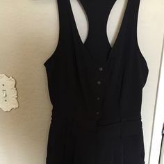 Silence and Noise romper from Urban Outfitters Sleeveless black romper with buttons down the front and belt loops. would look super cute right now to put a western belt on with it ! It's been worn once. silence + noise Other