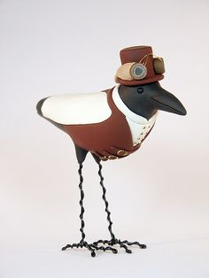 Top hat, goggles and tails steampunk crow made with polymer clay and wire frame. #Steampunk #polymerclay #crow
