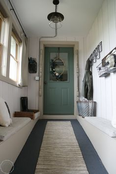Modern farmhouse mudroom makeover - complete with white batten walls