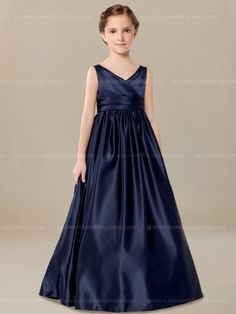Junior bridesmaid dress features a V-neckline and shirred full length skirt. A pleated band encrusted the waist for A-line silhouette. Available in 60 colors, shown in Navy.