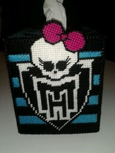 Monster High tissue cover. Looks cool to make either plastic canvas with yarn or maybe perler beads.
