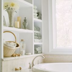 Built-in shelves above the tub are such a handy space for storing extra towels.