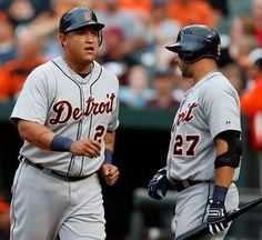 Miguel Cabrera of the Tigers, left, celebrates scoring against the Orioles with teammate Jhonny Peralta during the first inning in Baltimore on Friday. (Rob Carr/Getty Images)