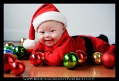Baby - Christmas - hardwood floors and ornaments laid around