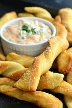 Homemade Soft Pretzel Twists with Creamy Buffalo Sauce. Amazing snack to serve at your Super Bowl party and every other party! Homemade soft, salted pretzels served with delicious creamy buffalo sauce. | from willcookforsmiles.com