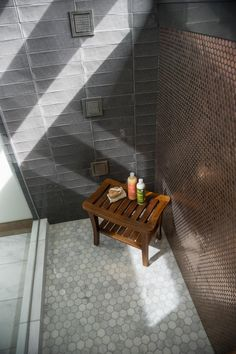 The master shower features a rain water showerhead, tech integration with music, LED lights and personalized temperature settings. AND a gorgeous mix of tiles.