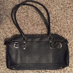New black handbag. No tags. Perfect condition. Black faux leather with buckles on the side. Bags