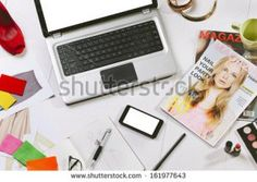 stock-photo-still-life-of-a-fashion-creative-space-overhead-of-a-essentials-objects-in-a-fashion-blogger-161977643