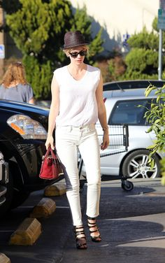 Keep an all-white look like Jones' from looking too monochrome by punctuating it with black accessories on the top and bottom, like a fedora hat and strappy heels.   - MarieClaire.com