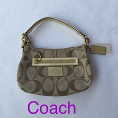 Authentic Coach Purse Authentic Coach purse with gold detailing and lavender interior. 1 exterior zip pocket and 1 interior zip pocket. Also a small side interior pocket. Comes with strap to make it longer. Very small spot on back of the bag as shown in last photo. Hardly noticeable. Coach Bags Shoulder Bags