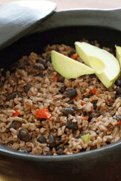 Arroz Congri (Cuban Rice and Black Beans) - - The aroma that fills your kitchen while cooking this Cuban rice and black beans dish, arroz congri, will make you want to pump up the salsa music and grab a mojito! Cuban Rice And Beans, Rice And Beans Recipe, Cuban Black Beans, Goya Black Beans And Rice Recipe, Spanish Rice And Beans, Cuban Recipes, Rice Recipes, Vegetarian Recipes, Cooking Recipes