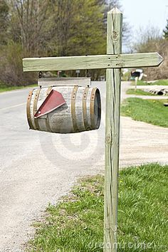 I saw an old wine barrel mailbox like this once, only it was on an old rod-iron stand. I dont know why I like this so much. It looks very hobbit-y to me, I guess :)