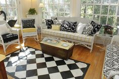 Yellow Black & White sun room Mixes many fabrics and patterns perfectly.