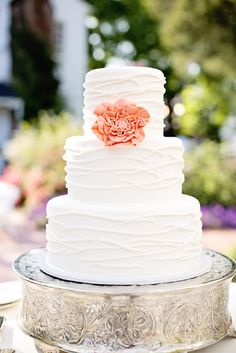 A simple white cake can be elevated with a single coral flower. Source: Fab You Bliss #weddingcake #coral