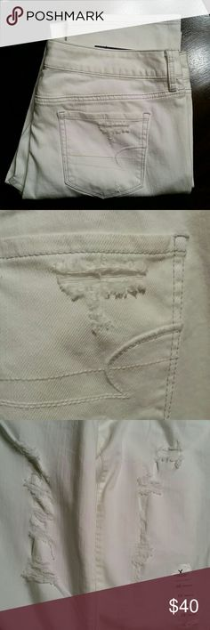 New American Eagle skinny jeans (#52) These are new with tags American Eagle jeans. Skinny, white destroy wash, low-rise, stretch. Size 12 regular. There are no stains on fabric. Smoke free home. American Eagle Outfitters Jeans