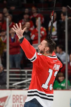 CM Punk celebrates after scoring a goal during Shoot the Puck! #Blackhawks