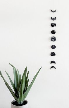 Stay in touch with the phases of the moon with this DIY marble moon phase wall hanging.