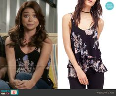 Haley's black floral top on Modern Family. Outfit Details: https://wornontv.net/80281/ #ModernFamily