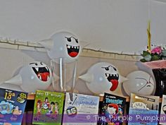 Make Boo balloon decorations for a Nintendo party using white balloons and marker pens!