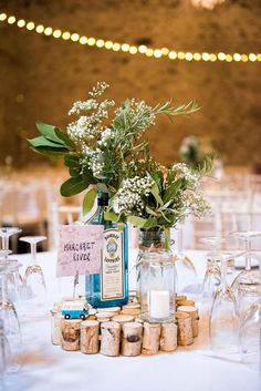 Rustic and gin inspired wedding centrepiece. Reuse old bottles in your centerpieces. A Beautiful Barn Wedding in Cumbria Jessic Grace Photography Bottle Centerpieces, Wedding Table Centerpieces, Centerpiece Ideas, Centerpiece Flowers, Wedding Table Centres, Flower Arrangements, Anna Campbell, Wedding Bottles, Barn Wedding Decorations