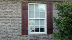 Charles bought 4 cedar pickets, cut to 5 foot. The other 1 1/2 foot used for cross section decoration. Shutters for one window $8. You are my DIY man! Love you honey.