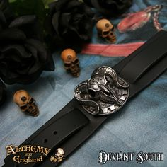 Alchemy Gothic A102 Gears Of Aiwass  Wide black leather wrist strap bearing large pewter ram's skull motif, with buckle fastening.