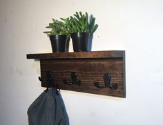 This wall mount key rack has a shelf and 3 double hooks. It's perfect for your entryway or kitchen for hanging your purse and keys. This rustic wood rack is stained and fully sealed to protect the wood. This piece has 2 predrilled holes and comes with screws and anchors for easy hanging. This will be handmade to order so there may be slight variations in color/finish. Please note this is not as large as a full size coat rack.