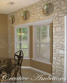 Love this handpainted faux stacked stone wall.