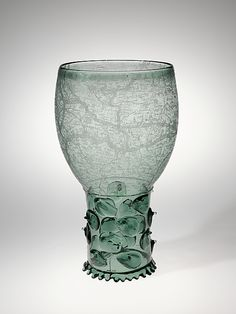 What's your style, plain or fancy? Check out this interactive feature and share your thoughts on works that can be considered both austere and ornate. | Goblet (Roemer), 17th century. The Metropolitan Museum of Art, New York. Gift of Mrs. Samuel P. Avery, 1904 (04.24)