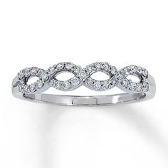 Elegant twists of 14K white gold and round diamonds are the featured attractions in this fine jewelry diamond ring, with a total diamond weight of 1/3 carat.