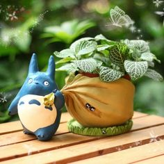 Where is Totoro going with that sack of acorns? Home, to your fairy garden! This adorable Totoro planter comes apart so you can easily water and tend to mini plants and succulents. Totoro planter is a fun addition to a bookshelf, window ledge or desk to Totoro, Mini Fairy Garden, Garden Art, Fairies Garden, Garden Design, Garden Ideas, Garden Planters, Planting Succulents, Succulent Plants
