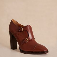 NAIRI CALF MONK-STRAP BOOTIE $795.00 Designed with a double-monk-strap silhouette and a sleek four-inch heel, the Nairi bootie marries menswear-inspired style with feminine elegance. Made in Italy from rich burnished calfskin, this dark-oak-hued shoe will elevate fall ensembles.