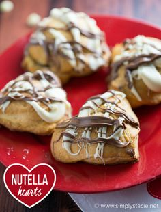 Nutella Hearts - Smooth, creamy Nutella nestled inside a buttery heart-shaped croissant with drizzled milk and white chocolate on top. This Valentine's Day dessert is sublime!