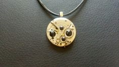 Just a little steampunk. Watch parts & rhinestones. Eco Chic Jewelry Designs