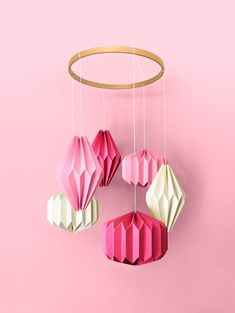"""A stunning hand crafted hanging mobile consisting of six individual geometric shapes folded from specialty stocks. A beautiful wooden """"halo"""" hovers above—complementing the materials below. A unique display worthy of any nursery or child's room. Nursery Room, Nursery Decor, Hanging Mobile, Kidsroom, Geometric Shapes, Pale Pink, Baby Shop, Babyshower, Halo"""