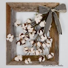 Cotton boll stems inside of a rustic barn wood frame create a charming wall decor piece you are sure to love! Bring some farmhouse style to any room of your home with this unique wall hanging. Open frame design looks beautiful hung on the wall, or as part of a collection on a table or mantle with the frame leaning against the wall. This country chic wall art is made with a very rustic barn wood frame. Cotton boll stems are attached to the frame and hang within the frame opening at an…