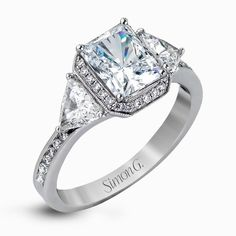 dazzling contemporary white gold ring with trillion cut diamond