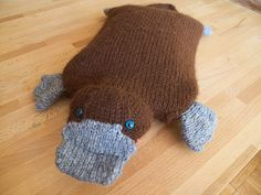Ravelry: Hot Water Platypus pattern by brella.I would buy a hot water bottle just for this purpose. Knitting For Kids, Knitting Projects, Crochet Projects, Sewing Projects, Art Projects, Circular Knitting Needles, Knitting Yarn, Knitting Patterns, Knitting Humor