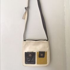 Orla Keily leather cross body bag Very unique bag from Orla Keily. Cream with brown and mustard yellow accents. All leather. There is a small mark on the back, lower right side of the bag (see third photo), otherwise in great condition. Orla Keily Bags Crossbody Bags