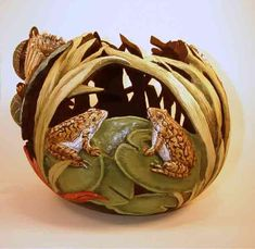 gourd art. Love the frogs hiding in the reeds